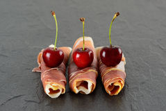 Prosciutto and cherries Royalty Free Stock Image
