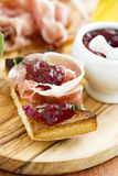 Prosciutto and cranberry appetizer Royalty Free Stock Image