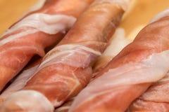 Prosciutto crudo detail close-up. An close-up detail on prosciutto crudo slice Royalty Free Stock Photo
