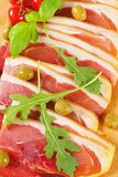 Prosciutto crudo and green olives Royalty Free Stock Photo