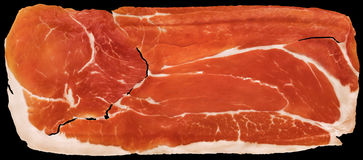 Prosciutto Cured Pork Ham Rasher Isolated On Black Background. Traditional, delicious, aromatic, gourmet, Dry Cured Pork Ham slice, isolated on Black background Stock Photography