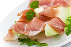 Prosciutto di Parma ham and three slice of melon Stock Image