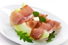Prosciutto di Parma ham and three slice of melon Royalty Free Stock Photos