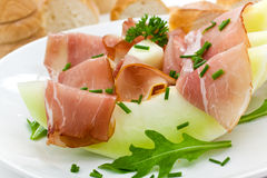 Prosciutto di Parma ham and three slice of melon Royalty Free Stock Photography