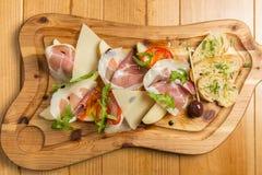 Prosciutto di Parma italiano, carne suina curata Immagini Stock