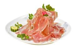 Prosciutto di Parma italiano tradizionale dell'aperitivo con il melone - melone di prosciutto di Parma con fondo bianco Fotografia Stock Libera da Diritti