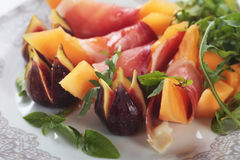 Prosciutto di Parma with melon and figs Stock Photos