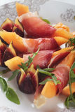 Prosciutto di Parma with melon and figs Royalty Free Stock Images