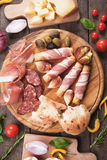 Prosciutto di Parma and other italian food Stock Photos