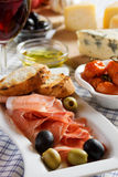 Prosciutto di Parma served as appetizer. Prosciutto di Parma served as antipasto, traditional italian appetizer Royalty Free Stock Photo
