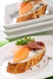 Prosciutto e canapes do queijo azul Foto de Stock Royalty Free