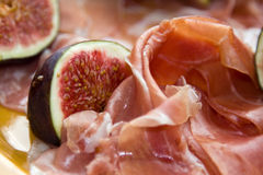 Prosciutto with fig. Food theme. Prosciutto with fig Royalty Free Stock Photos