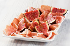 Prosciutto and figs Stock Photos
