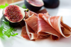 Prosciutto with fresh figs royalty free stock photos