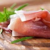 Prosciutto with fresh rosemary royalty free stock photos