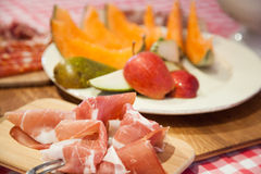 Prosciutto and fruit, typical Tuscany. Royalty Free Stock Photos