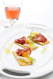 Prosciutto goat cheese canapes Stock Images