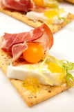 Prosciutto goat cheese canapes stock photography