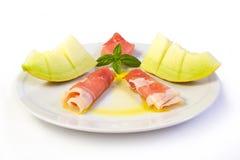 Prosciutto grezzo e melone giallo Fotografie Stock Libere da Diritti