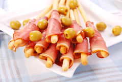 Prosciutto with grissini Stock Images