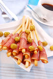 Prosciutto with grissini Stock Photography
