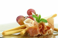 Prosciutto with grissini appetizer Stock Photos