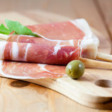 Prosciutto with grissini and arugula Stock Photography