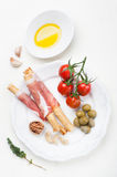 Prosciutto ham bread sticks with olive oil and tomatoes Stock Images