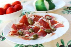 Prosciutto ham with capers Stock Photo