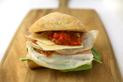 Prosciutto Ham and Cheese sandwich. With Roasted Red Peppers on Ciabatta Bread Royalty Free Stock Images