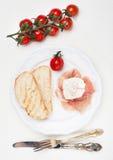 Prosciutto ham, ciabatta, poached egg. Royalty Free Stock Photos