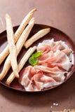 Prosciutto ham and grissini bread sticks Royalty Free Stock Image