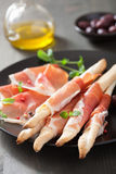 Prosciutto ham and grissini. italian antipasto Stock Image