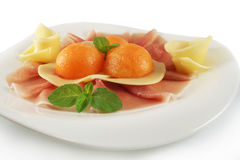 Prosciutto ham, melon and cheese Stock Photography