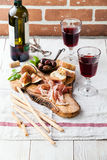 Prosciutto ham, Olives and red Wine Stock Photo