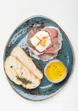 Prosciutto ham,  poached egg, chiabatta. Breakfast Royalty Free Stock Photos