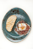Prosciutto ham,  poached egg, chiabatta. Royalty Free Stock Photos