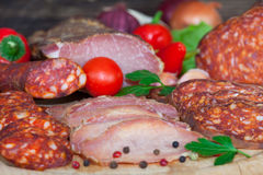 Prosciutto ham, salami and sausage Stock Photos