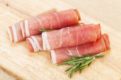 Prosciutto with herbs Stock Photo