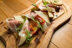 Prosciutto italiano, carne de carne de porco curada fotografia de stock royalty free