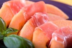 Prosciutto italien et melon Photographie stock