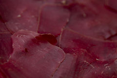 Prosciutto Meat Texture. Here is a stock photo texture of deep red sliced prosciutto meat. It could be used for backgrounds, blending, or more Royalty Free Stock Photo