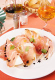 Prosciutto with melon on a big white plate Royalty Free Stock Photos