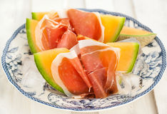 Prosciutto with melon Stock Photos