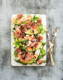 Prosciutto, melon, fig and soft cheese salad on a Royalty Free Stock Photos