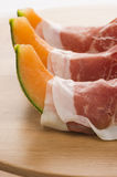 Prosciutto with melon macro Royalty Free Stock Photo