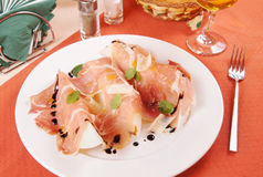 Prosciutto with melon on a plate Stock Images