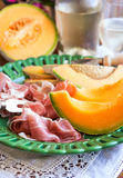 Prosciutto with melon Stock Images