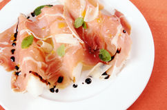 Prosciutto with melon on a white plate Royalty Free Stock Photos