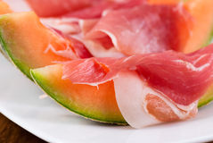 Prosciutto with melons Stock Photos